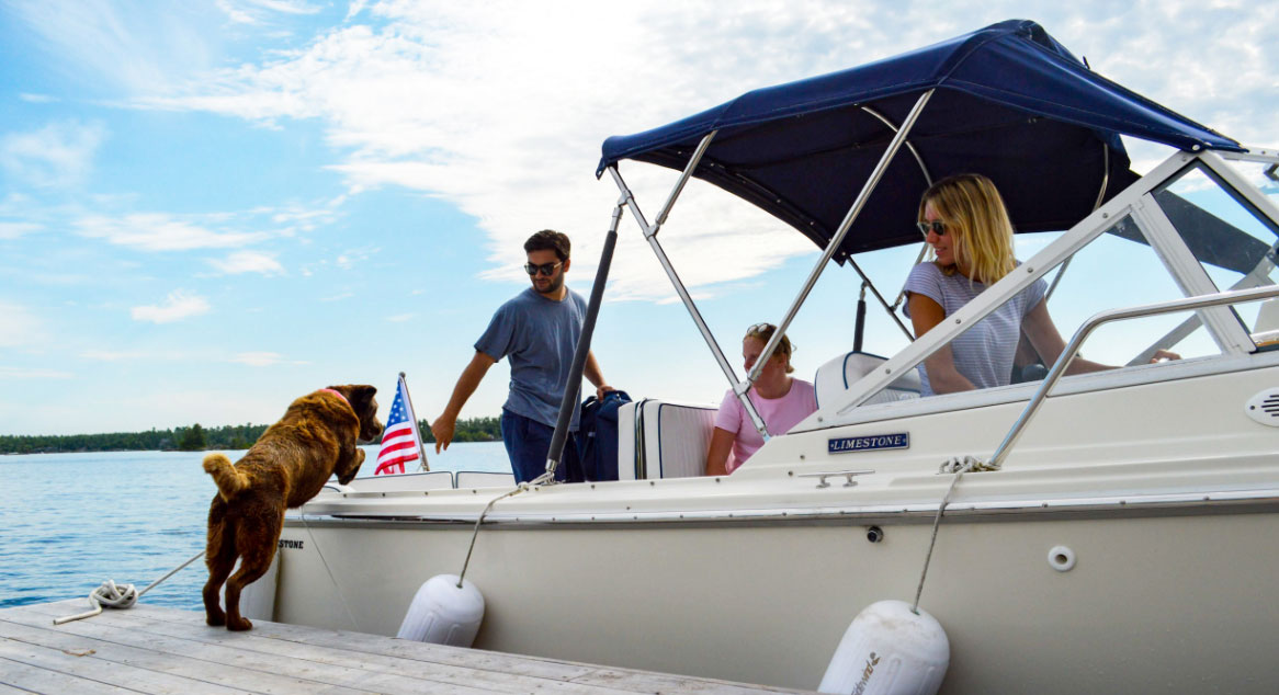 Family and dog getting on a Limestone boat