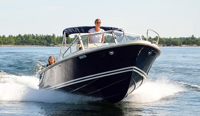 woman driving a limestone boat